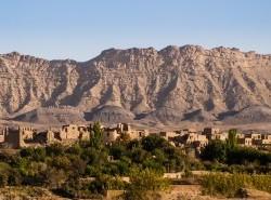Avia - Mud_Village_and_Karkas_Mountains,_Iran_(16202155706)1.jpg